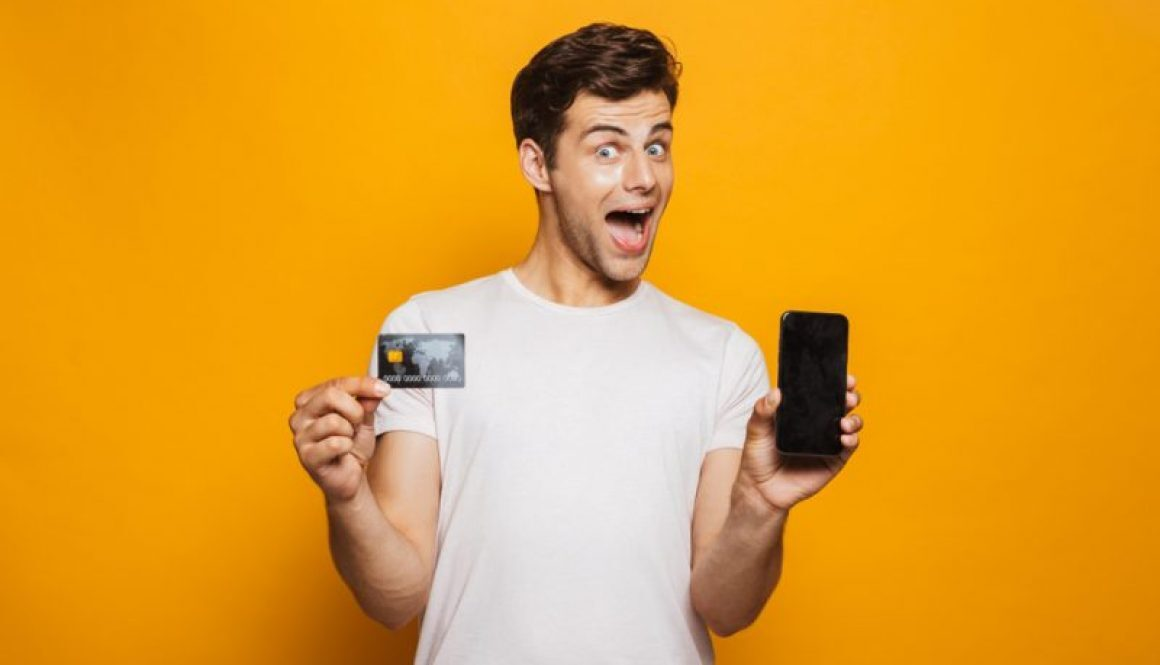 """Happy Man getting approved for a credit card."""