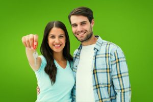 """""""Happy Couple Holding House Key After Getting Home Loan.""""